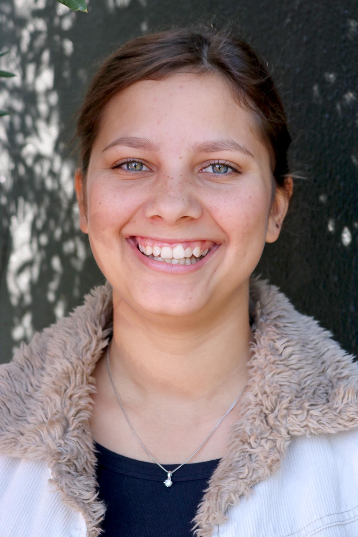 Image of Keisha smiling at the camera